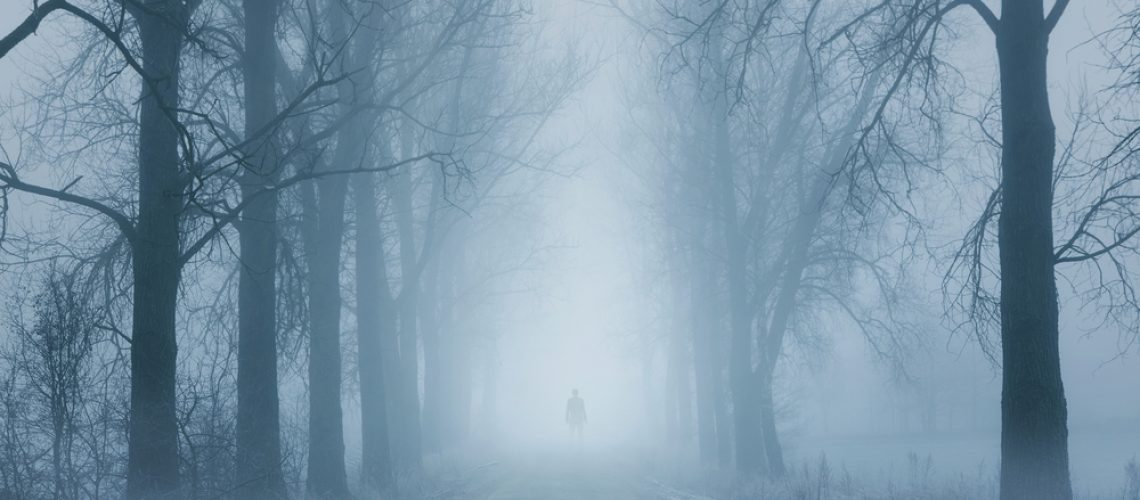 Silhouette,Of,A,Lonely,Man,Standing,On,The,Foggy,Road