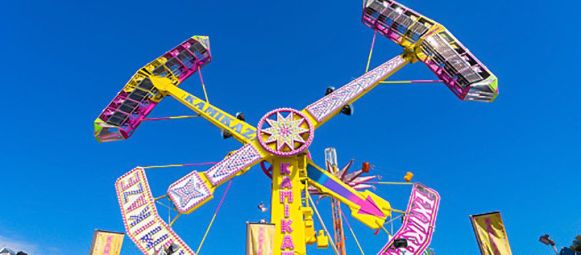 Melbourne, Australia - September 25, 2015: People enjoying the Pendulum amusement ride in the carnival precinct of the 2015 Royal Melbourne Show. The Show is the largest and most iconic annual community event in Victoria.