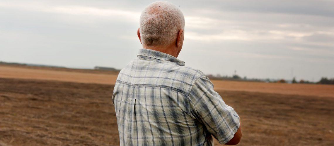 Man,Aged,Against,Background,Of,Sad,Landscape