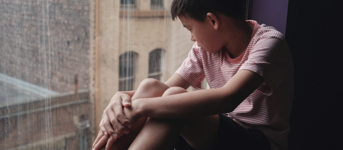 Sad,Asian,Preteen,Boy,Feeling,Lonely,,Looking,Out,Of,Window