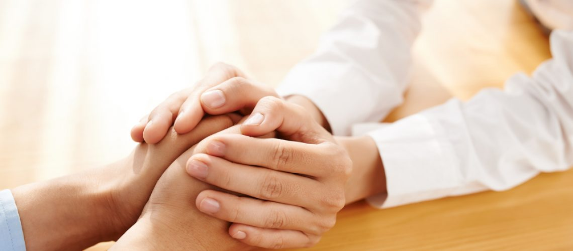 Hands,Of,Woman,Reassuring,Her,Colleague