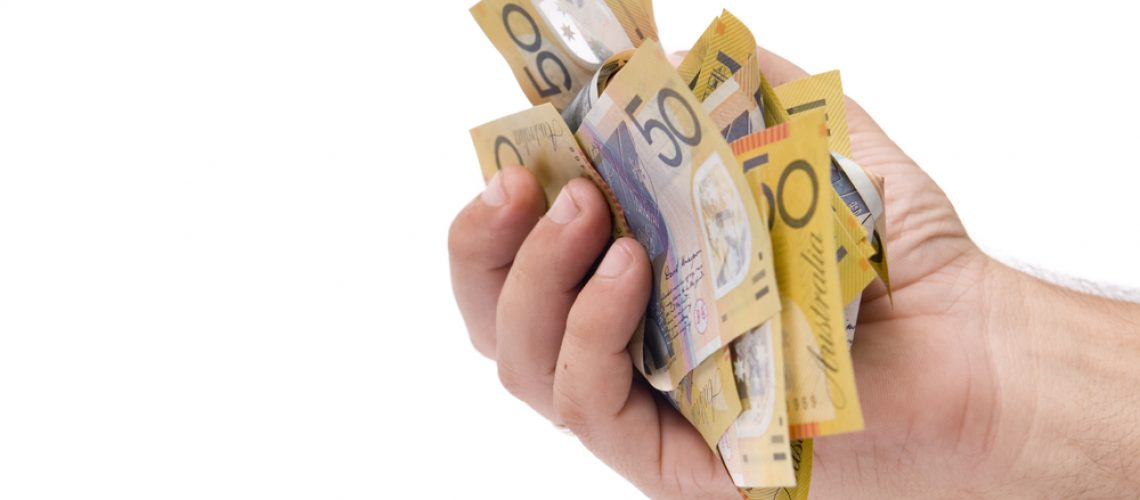 Hand,Holding,A,Fistful,Of,Australian,Fifty,Dollar,Bills,Isolated