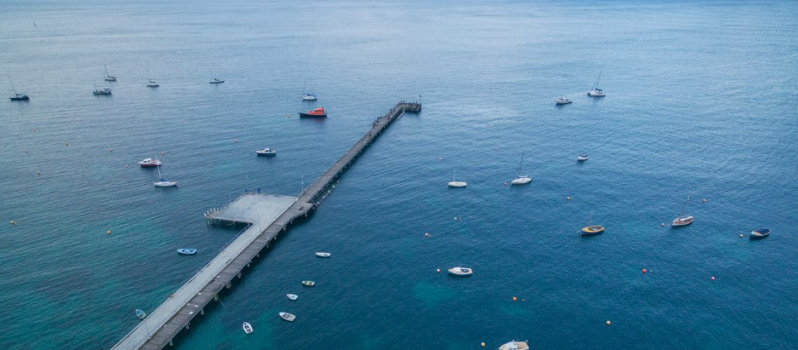 Aerial,View,Of,Flinders,Pier,With,Moored,Fishing,Boats,At